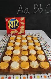 sp ritz crackers topped with cute cheese shapes are a tasty after