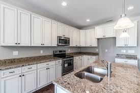 white vs antique white kitchen cabinets york antique white cabinets