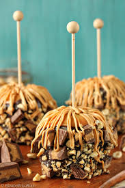 candy apples for halloween peanut butter caramel apples with chocolate peanuts peanut