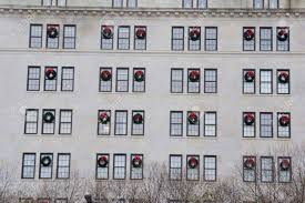 Wreaths For Windows Many Wreaths On Building Windows Wreaths Stock Photo