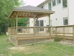 divine home exterior design ideas using lattice wood deck along