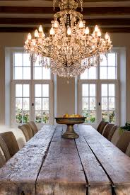farmhouse dining room table and a dramatic elegant chandelier over