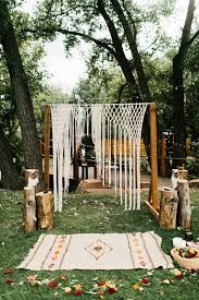 wedding arch log picture of boho wedding arch with a macrame hanging an