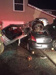 corvette car crash corvette lands on toyota yaris in canadian driveway crash