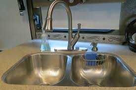 how to remove faucet from kitchen sink rebooted replacing our kitchen faucet