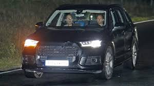audi matrix headlights 2016 audi q7 spied in the night with very thin camouflage and
