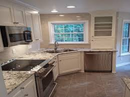 sinks marble countertop with stainless steel gas range and wall