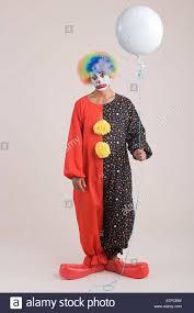 clown balloon a clown holding a balloon stock photo royalty free image