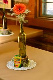 simple gerbera daisy and baby u0027s breath in a wine bottle made an