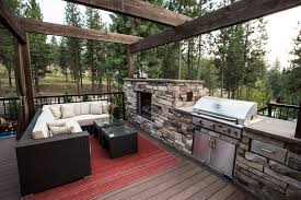 fireplace wood beam with pine trees deck transitional and