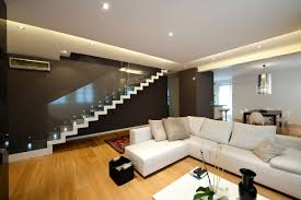 minimalist family room design with white sofa furniture and stair