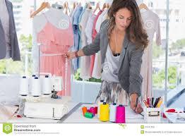 fashion designer fashion designer measuring a mannequin royalty free stock photos