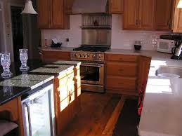 Pictures Of Stainless Steel Backsplashes by Stainless Steel Vs Tile Backsplash