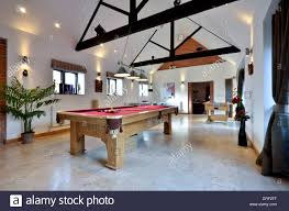 large games room with pool and table football stock photo royalty