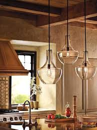 stunning rustic kitchen featuring beautiful clear glass pendant
