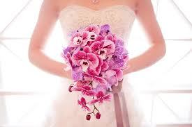 wedding flowers orchids cascading wedding bouquet of purple pink orchids