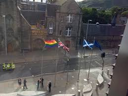 queen greeted with rainbow flag at state opening of scottish