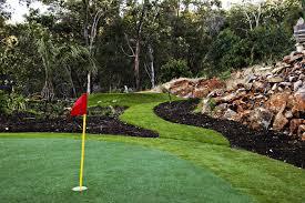 Making A Backyard Putting Green Ccgrass Golf Putting Green Embellishes Courtyard Landscape