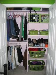 alluring open closet organizing ideas with multicolored clothes