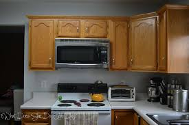 How To Paint Wooden Kitchen Cabinets by Painted Kitchen Cabinets Before And After What Does She Do All Day