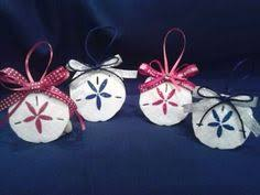 paint a sand dollar with glitter glue to make a simple and