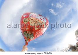 singing balloon holding a heart sweet saying i you stock photo