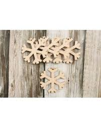 slash prices on snowflake ornaments wood