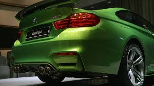 java green bmw this bmw m4 java green is packed with extra goodies and more power