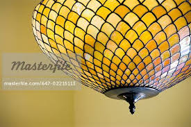 Stained Glass Ceiling Light Yellow Stained Glass Ceiling Light Stock Photo Masterfile