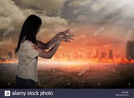 background halloween scary female zombie with burning city background halloween