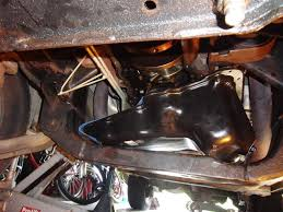 removing an oil pan from a kj jeep liberty without removing or