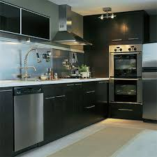 kitchens with stainless steel backsplash sophisticated black kitchen set with cool stainless steel