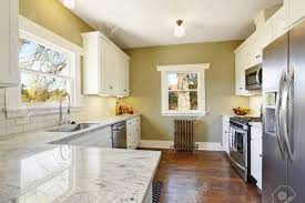 kitchen paint colors with white cabinets and stainless appliances freshly updated kitchen room accented with green olive walls