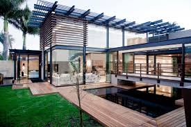 minimalist modern minimalist opulent luxury home with lots of glass steel and wood
