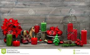 vintage christmas decorations with red candles and flower poinse