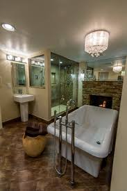 bathroom master bathroom design with wall gas fireplace and