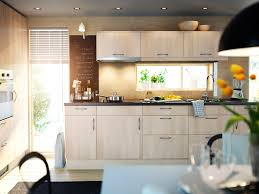 white kitchen peninsula black countertop ellajanegoeppinger com