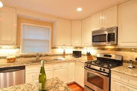 kitchen remodel white cabinets tile backsplash undercabinet