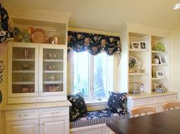 fascinating white bay windows design with floral blur valance also