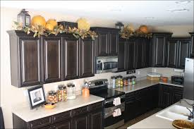 ideas for space above kitchen cabinets kitchen kitchen cabinet tops decorating ideas for above kitchen