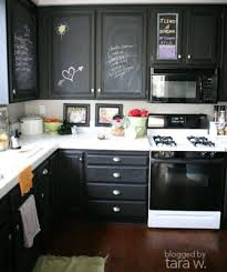 painting your kitchen cabinets black i can see it with glass doors and stainless steel
