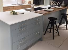 contemporary kitchen island design with painted blue shaker doors