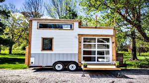 fresh bright tiny house with built in garage glass door roll up