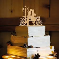 10 wedding cake toppers for every type of wedding woman getting