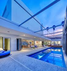 florida house plans with courtyard pool tall florida home with open indoor outdoor hallways