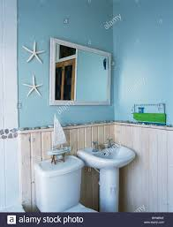 Tongue And Groove In Bathrooms Mirror Above White Pedestal Basin And Limed Wood Tongue Groove