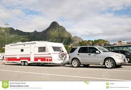 luxury car caring caravan with bikes on royalty free stock image