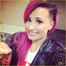 demi lovato smiles wide after shaving some of her pink hair off