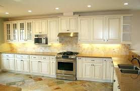 how to glaze kitchen cabinets cream colored cabinets cream cabinet with brown glaze cream glazed