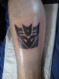 dinobot transformers logo tattoos pictures to pin on pinterest